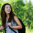 Pretty laughing girl wearing backpack - Stock Photo