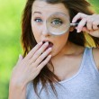 Funny girl with loupe — Stockfoto
