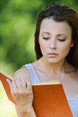 Beautiful girl reading book — Stock Photo
