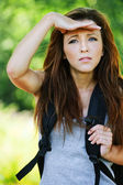 Portrait of pretty girl wearing grey t-shirt and backpack — Stock Photo