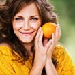 Pretty woman holding orange — Stock Photo #6645797