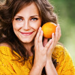 Stock Photo: Pretty woman holding orange