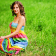 Young beautiful woman sitting on grass - Stockfoto