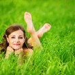 Young woman lying on grass — Stock Photo #6645804