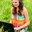 Young woman working with laptop — Stock Photo #6645806