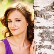 Stock Photo: Cute dark-haired woman near birch tree
