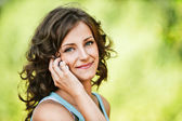 Beautiful woman speaking on mobile phone — Stok fotoğraf