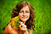 Portrait of beautiful woman holding bouqet of yellow flowers — Stock Photo
