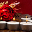 Roses and candles on a red background — Stock Photo
