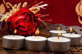 Roses and candles on a red background — Stockfoto
