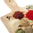 Stock Photo: Different spices on wooden desk