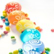 Colorful Easter eggs with sweets — Stock Photo