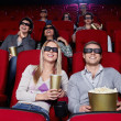 Youth at cinema — Stock Photo
