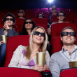 Young in 3D cinema — Stockfoto