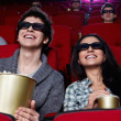 Smiling couple at cinema — Stock Photo