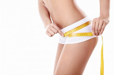 Young girl measuring hip