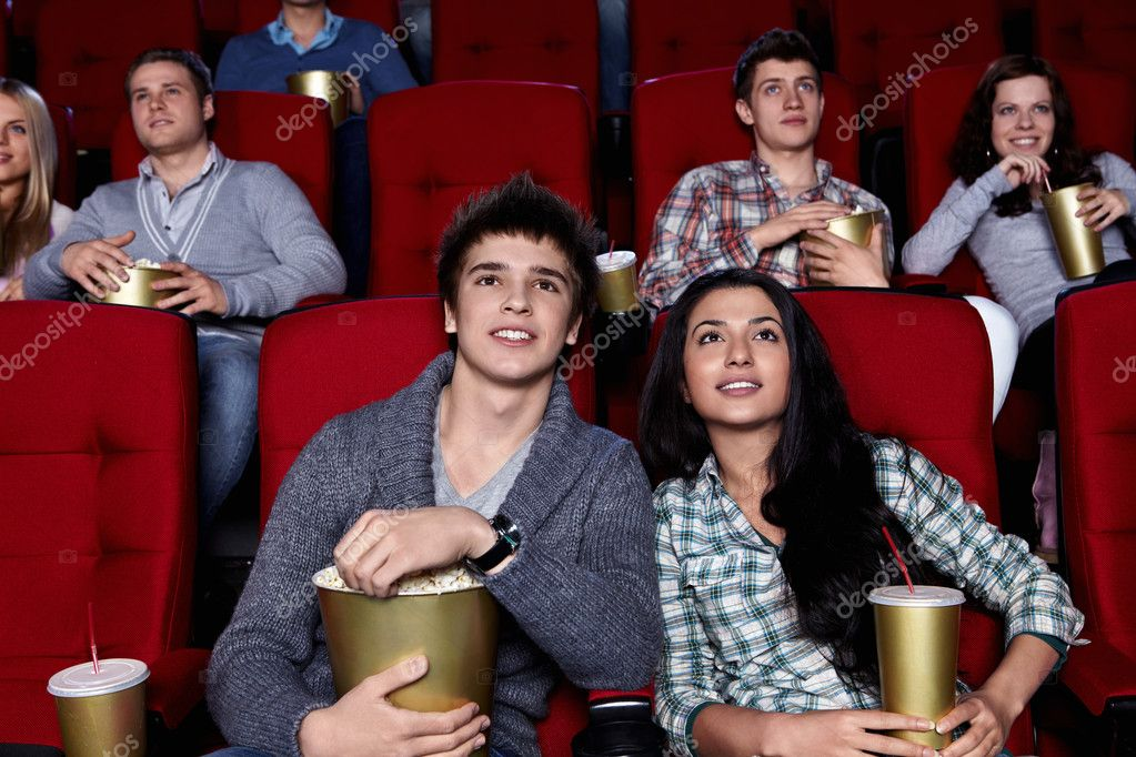 Young are closely watching a movie at the cinema — Stock Photo #5380607