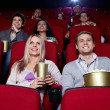 Happy in the cinema — Stock Photo