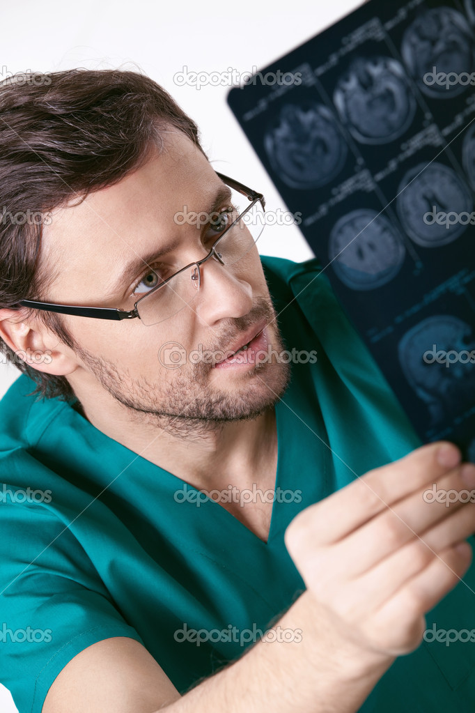 The young doctor examines an x-ray patient — Stock Photo #5461805
