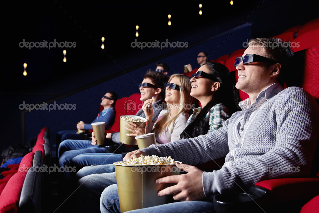 Young watch movies in cinema  Stock Photo #5551251