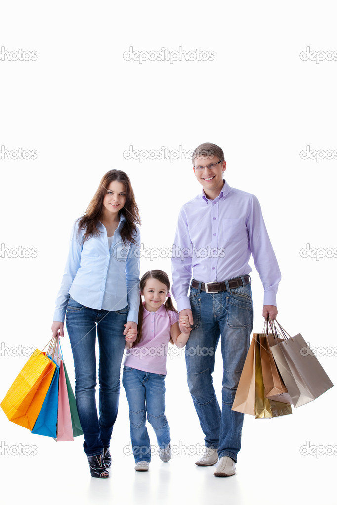Parents with a child with shopping on white background  Stock Photo #5601178