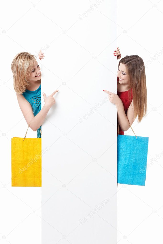 Beautiful girl with shopping bags and billboards — Stock Photo #5689420