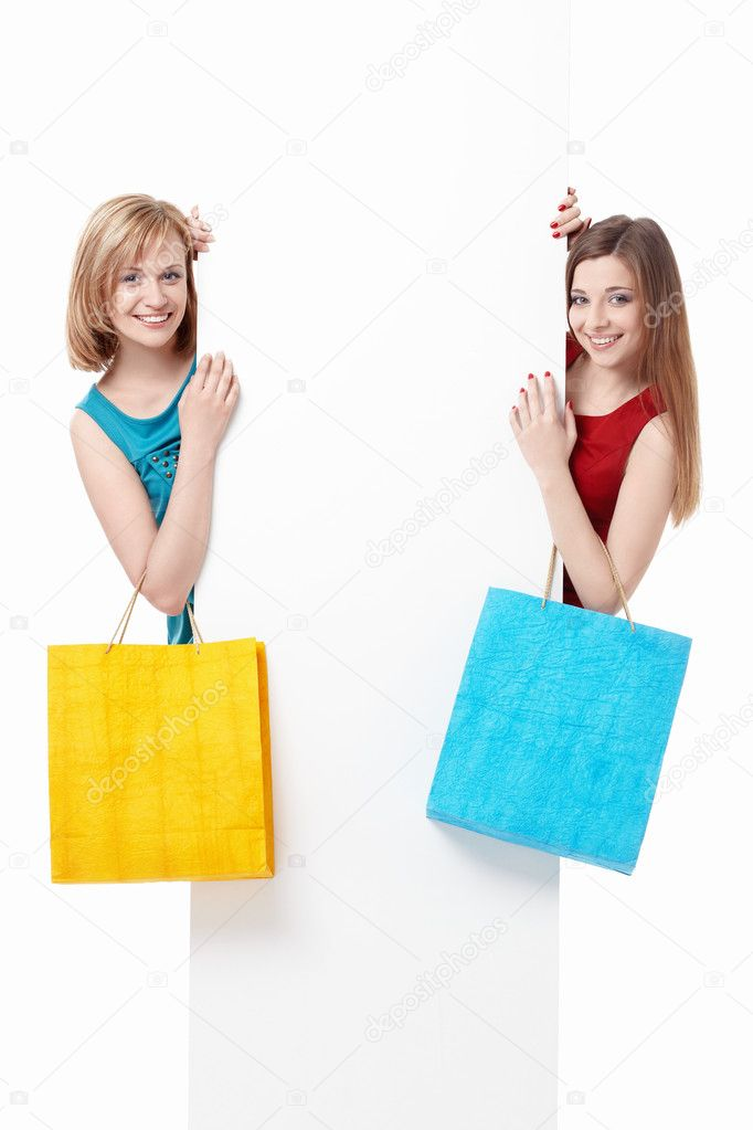 Beautiful girl with shopping bags and billboards — Stock Photo #5689425