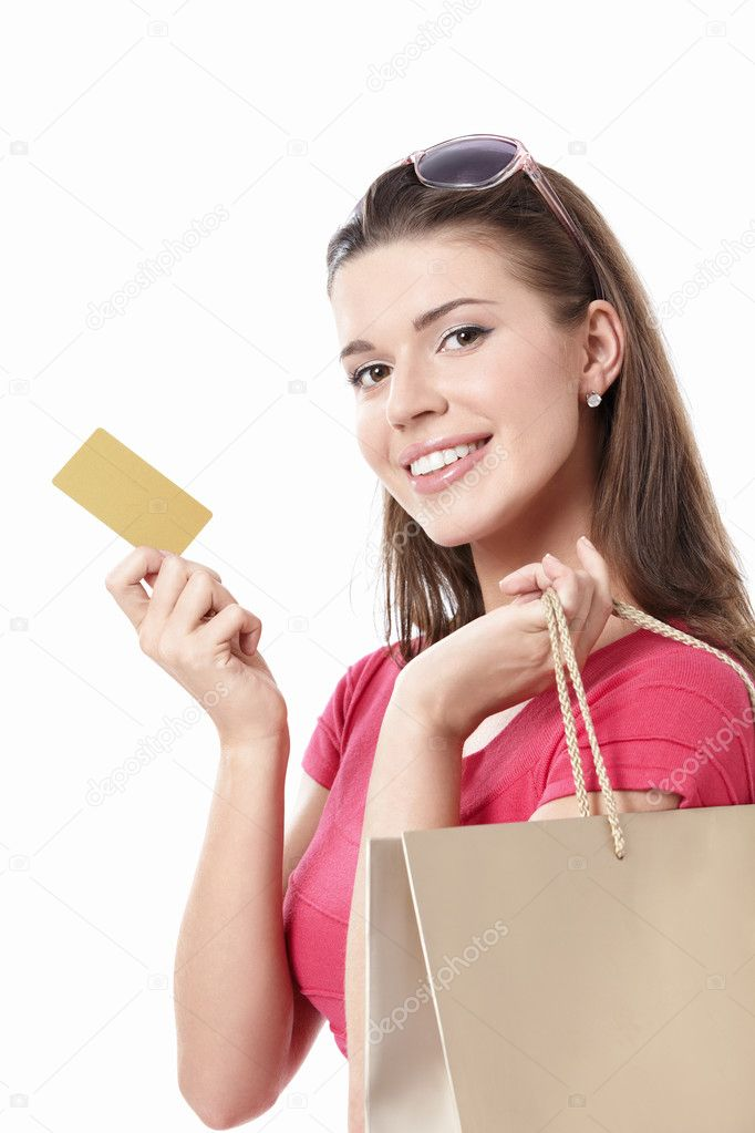 Young woman with shopping bags and credit card on a white background  Stock Photo #5751925