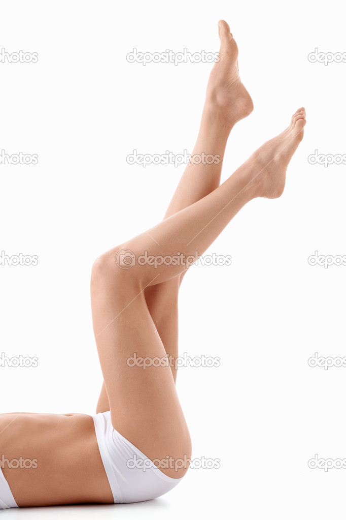 Beautiful legs young girl on a white background — Stock Photo #5752041