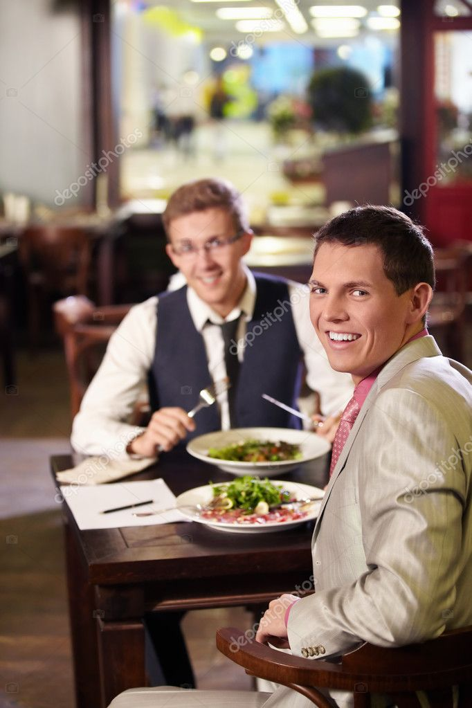 Two men having lunch in a restaurant  Stock Photo #6071518