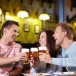 Stockfoto: Young with a beer