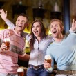 Стоковое фото: Young are expressing in pub