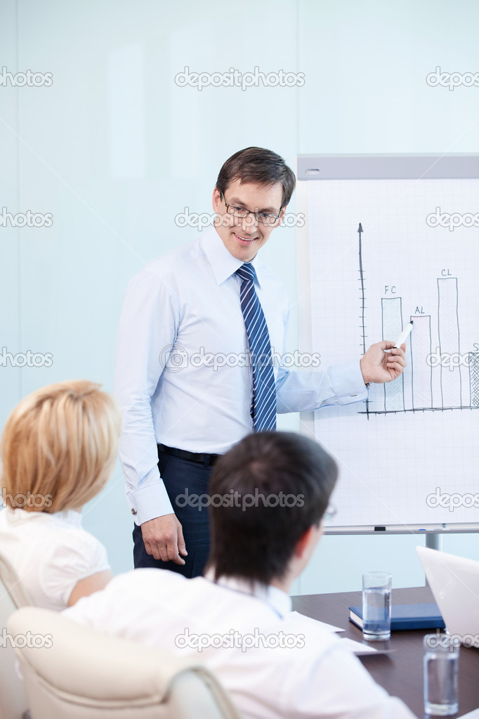 Mature man shows a graph of the staff  Stock Photo #6462559