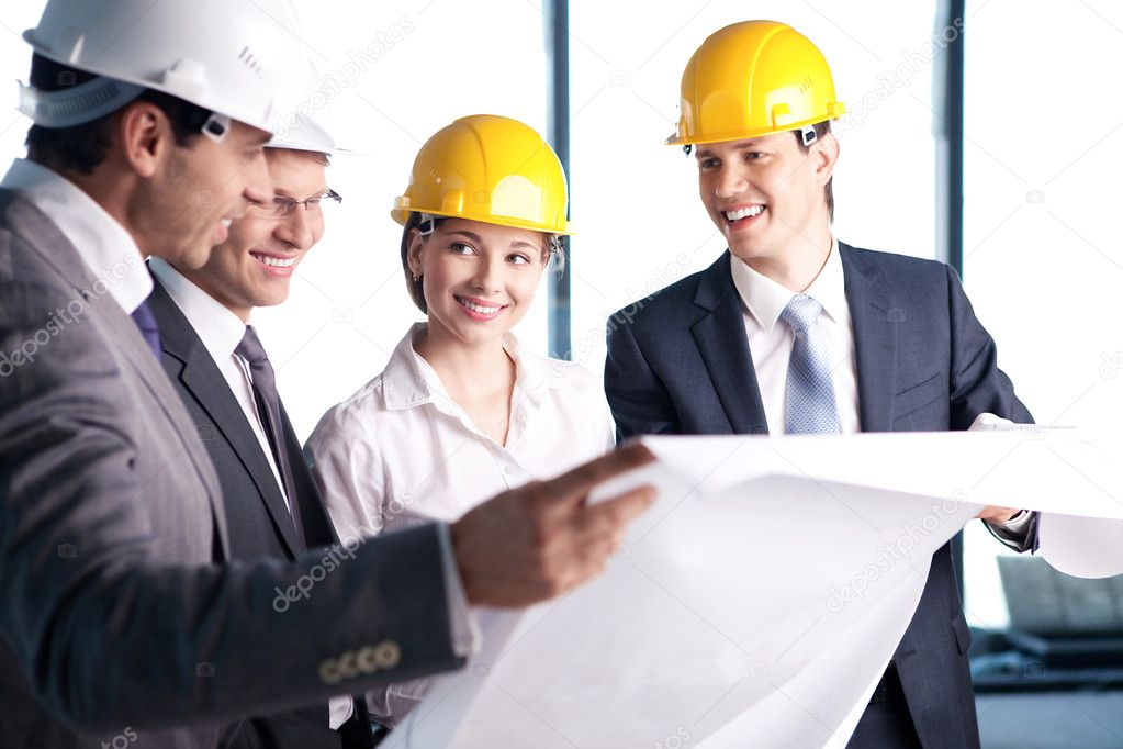 In helmets on a construction site — Foto Stock #6462616