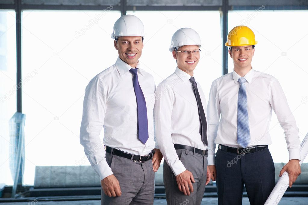 Men in helmets on a construction site  Stock Photo #6462621