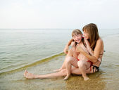 Mother and daughter on the beach — Stock Photo