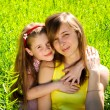 Smiling young mother with little daughter — Stock Photo