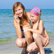 Mother and daughter on the beach — Stock Photo #6117287