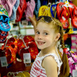 Stock Photo: Little girl in a shoe store
