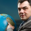 Business man with globe close up — Stock Photo