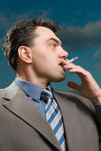 Business man with cigarette close up — Stock Photo