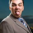 Businessman shows tongue — Stock Photo