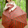 Girl with an umbrella in a summer park — Stock Photo