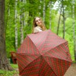 Girl with umbrella in park — Stock Photo