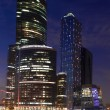 Modern skyscrapers at a evening — Stock Photo