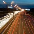 Automobile lights on highway — Stock Photo