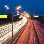 Automobile lights at night — Stock Photo