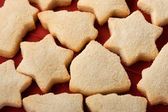 Biscuits on red close up — Stock Photo