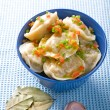 Stock Photo: Pelmeni with garlic and bay leaf