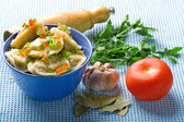 Pelmeni and garlic and bay leaf — Stock Photo